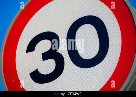 A 30 miles per hour (mph) speed restriction sign. - Stock Photo