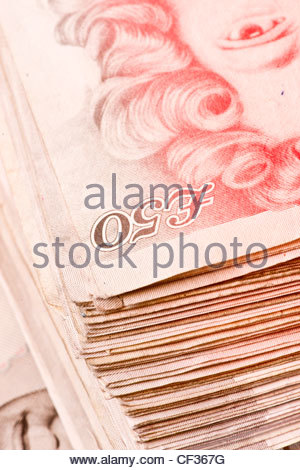 Banknotes cash money British pounds sterling Euro Euros Eur Europe European currency £50 50 fifties fifty pile sterling - Stock Photo