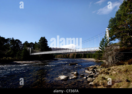 Suspension bridge over the River Dee. Since the 17th century, anglers have been sport fishing the river for its - Stock Photo