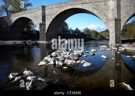 A view toward Potarch Bridge over the River Dee. - Stock Photo