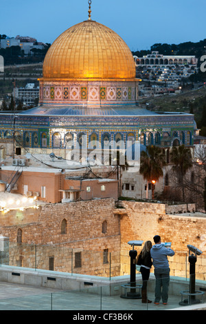 Israel,Jerusalem,couple at an overview of the Dome of the Rock and the Wailing Wall at dusk - Stock Photo