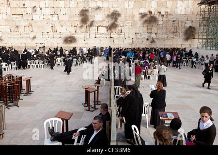 Israel,Jerusalem, The Wailing Wall, showing the wall that segregates men from women praying - Stock Photo