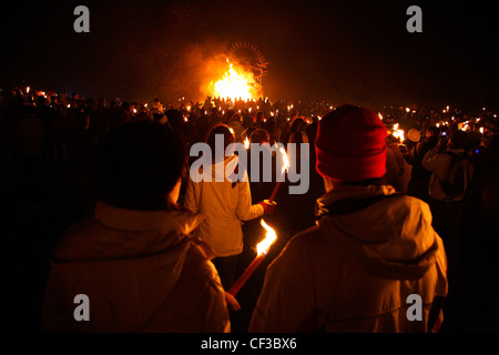 A crowd of people looking toward the  Calton Hill Bonfire in Edinburgh. - Stock Photo