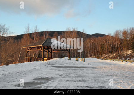 A scenic rest stop in winter along the Kancamagus Highway, in New Hampshire's White Mountain National Forest - Stock Photo