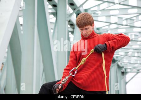 man with equipment rope bridge - Stock Photo