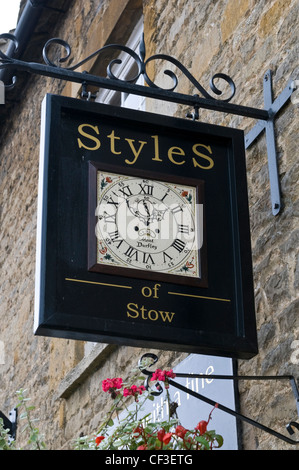Looking up at the shop sign for the antique specialists Styles of Stow. - Stock Photo