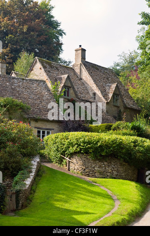 A garden path leading to traditional Cotswold cottages in the village of Bibury. - Stock Photo
