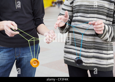 two teens with yo-yo toys in their hands. focus on clothes - Stock Photo