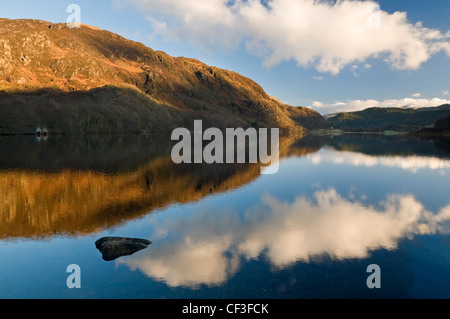 The sky reflected in Llyn Dinas lake in the Nant Gwynant valley.