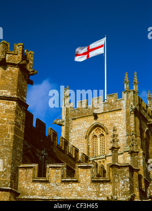 The flag of St George flying from the tower of St Bartholomew's late Medieval church which was originally founded - Stock Photo