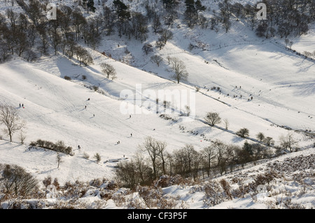 People enjoying the winter slopes of the Hole of Horcum in the North York Moors National Park. - Stock Photo