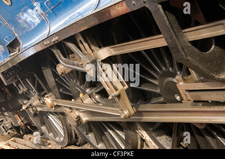Close up of the wheels of the steam locomotive Sir Nigel Gresley. - Stock Photo