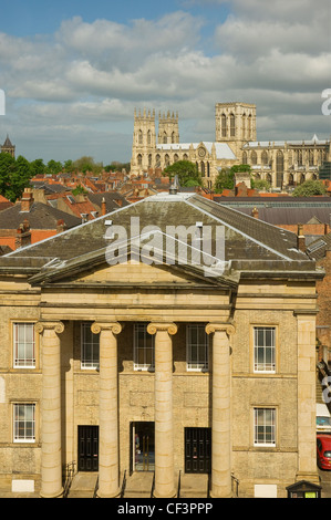 A view over the Central Methodist Church with York Minster in the background. - Stock Photo