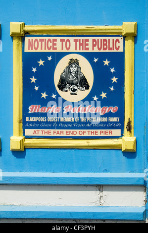 Spiritualist's advert on central pier in Blackpool. - Stock Photo