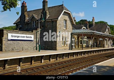 Passengers on the platform at Grange-over-Sands railway station, built in 1864. - Stock Photo