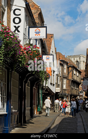 People shopping in The Shambles, often called Europe's best preserved medieval street. - Stock Photo