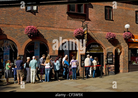 Visitors queuing outside the entrance to the Jorvik Viking Centre in summer. - Stock Photo