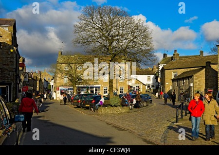 Bustling cobbled square in the centre of Grassington in Wharfedale in the Yorkshire Dales National Park.