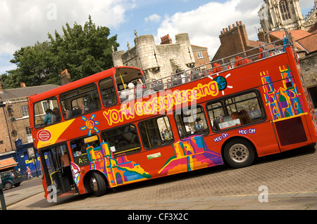 York City sightseeing tour bus stopping at Exhibition Square. - Stock Photo