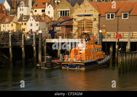The RNLI lifeboat George and Mary Webb moored outside the lifeboat station in Whitby Harbour. - Stock Photo