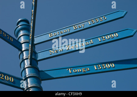 A signpost showing distances and directions from Whitby of Captain Cook's voyages. - Stock Photo