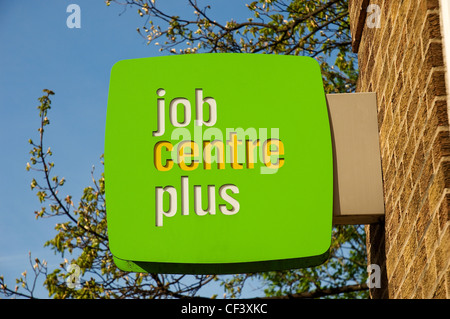 Job Centre Plus sign on wall. - Stock Photo