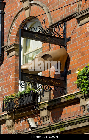 The Golden Slipper (Free House) sign hanging outside the pub in Goodramgate. - Stock Photo
