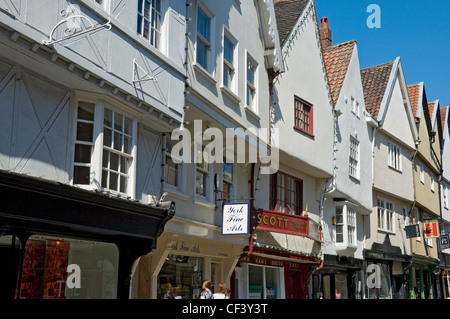Storefronts in Low Petergate in summer. Petergate is named after its proximity to York Minster which is dedicated - Stock Photo
