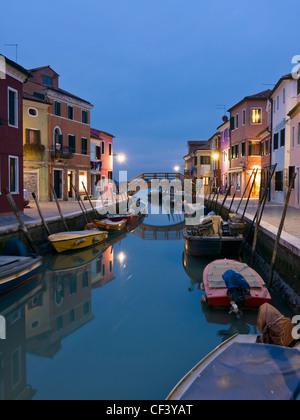 Canal reflections at dusk in Burano island - Venice, Venezia, Italy, Europe - Stock Photo