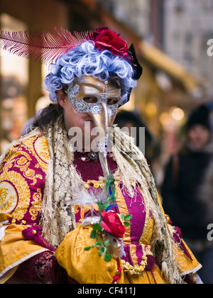 A woman wearing a carnival mask and costume in San Marco district - Venice, Venezia, Italy, Europe - Stock Photo