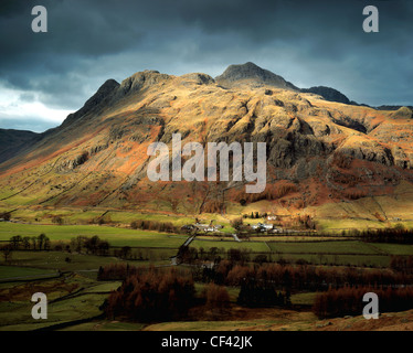 Looking across the remote and rugged Langdale Valley in the Lake District. - Stock Photo