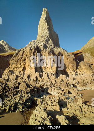 Towering cliffs dominate Mewslade Bay to give it a primordial appearance. - Stock Photo