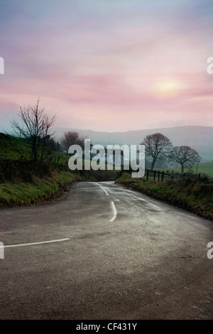 A country road running through the heart of rural Cheshire on a misty winter's day. - Stock Photo
