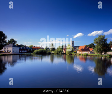 View across one of several large ponds towards the picturesque village of Great Massingham. - Stock Photo