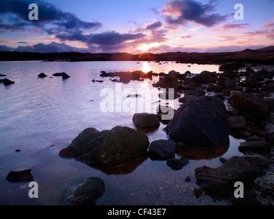 Winter sunset over Loch Eigheach on Rannoch Moor. - Stock Photo