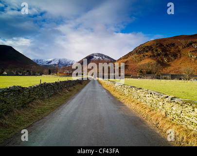 Looking along a quiet lane towards the remote Cumbrian village of Mungrisdale in the Lake District. - Stock Photo