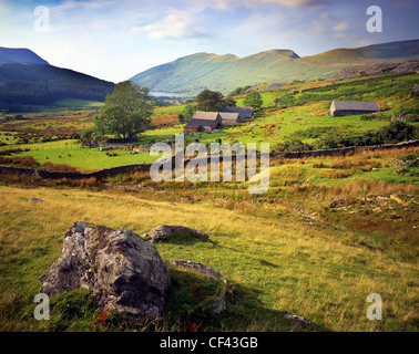 Looking west across farmland on the lower slopes of the Snowdonia mountains. - Stock Photo
