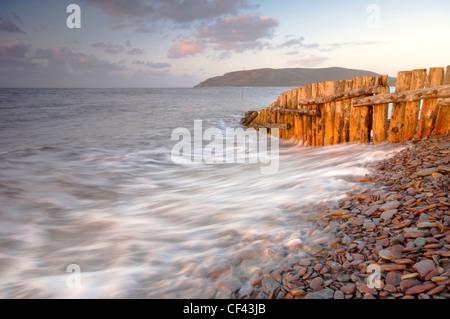 Waves on the pebbly beach at Porlock Weir. - Stock Photo