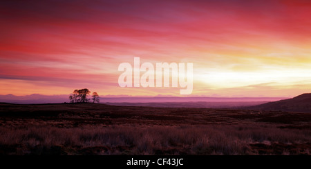 Beautiful red sky at daybreak over the North Yorkshire Moors. - Stock Photo