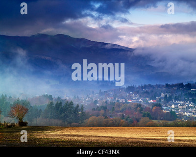 A misty dawn over the town of Pitlochry. - Stock Photo