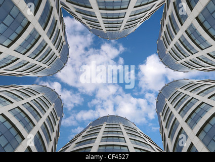 many skyscrapers on sky background, collage - Stock Photo