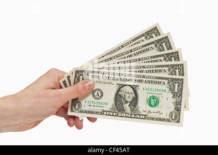Five 1 U.S. Dollar bills are held in the hand, white background - Stock Photo