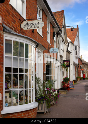 A view of shop fronts in Lavenham. This famous Suffolk village, popular with tourists, was built on the back of - Stock Photo