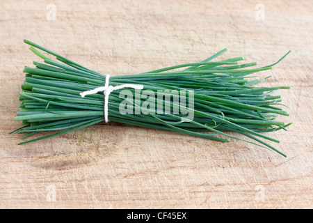 Chives on a wooden surface - Stock Photo