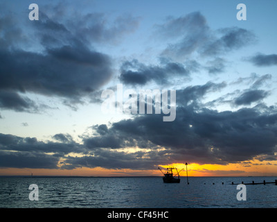 Winter sky off Southend. Originally the south end of the village of Prittlewell, Southend became a popular seaside - Stock Photo