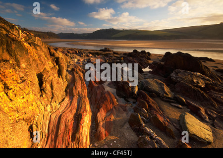 Dawn over Mothecombe beach at the estuary of the River Erme. - Stock Photo
