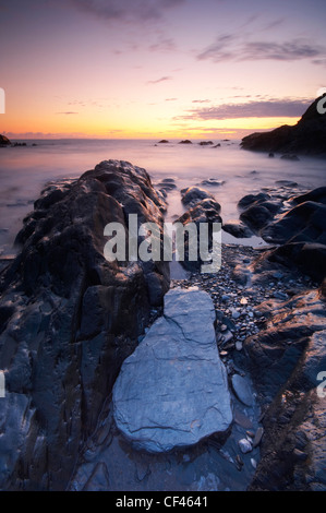 Sunset over Combesgate beach bay at Woolacombe on the North Devon coast. - Stock Photo