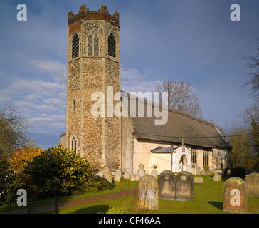 Exterior view of All Saints Church. The church tower dates back to around 1300 and is one of only six in Norfolk - Stock Photo