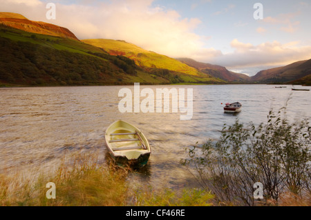 Autumn view of small rowing boats on Tal Y Llyn lake in Snowdonia.