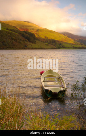 Autumn view of a small rowing boat on Tal Y Llyn lake in Snowdonia.